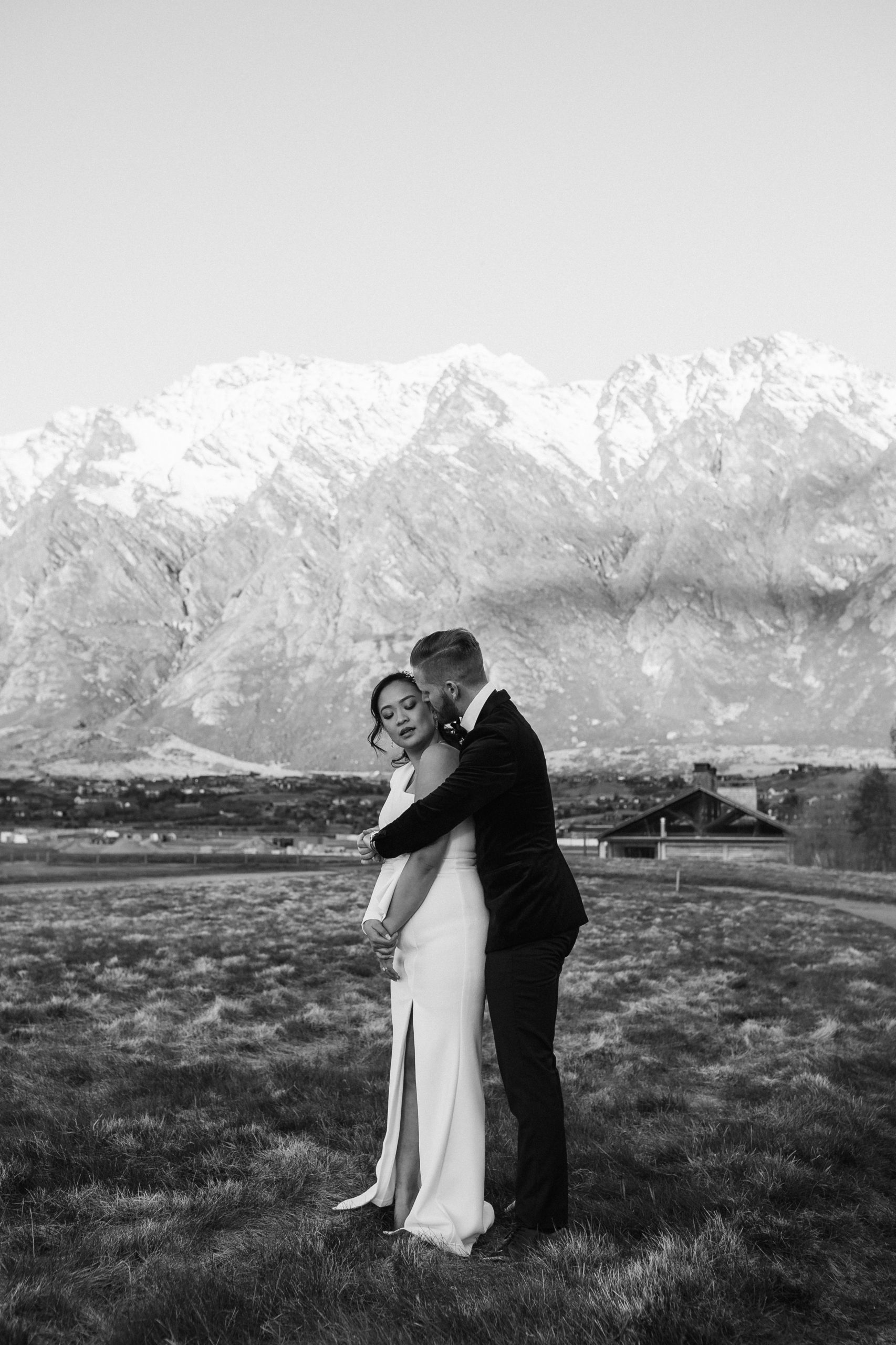 Bride and groom embracing Modern Classic winter wedding at Jack Point in Queenstown