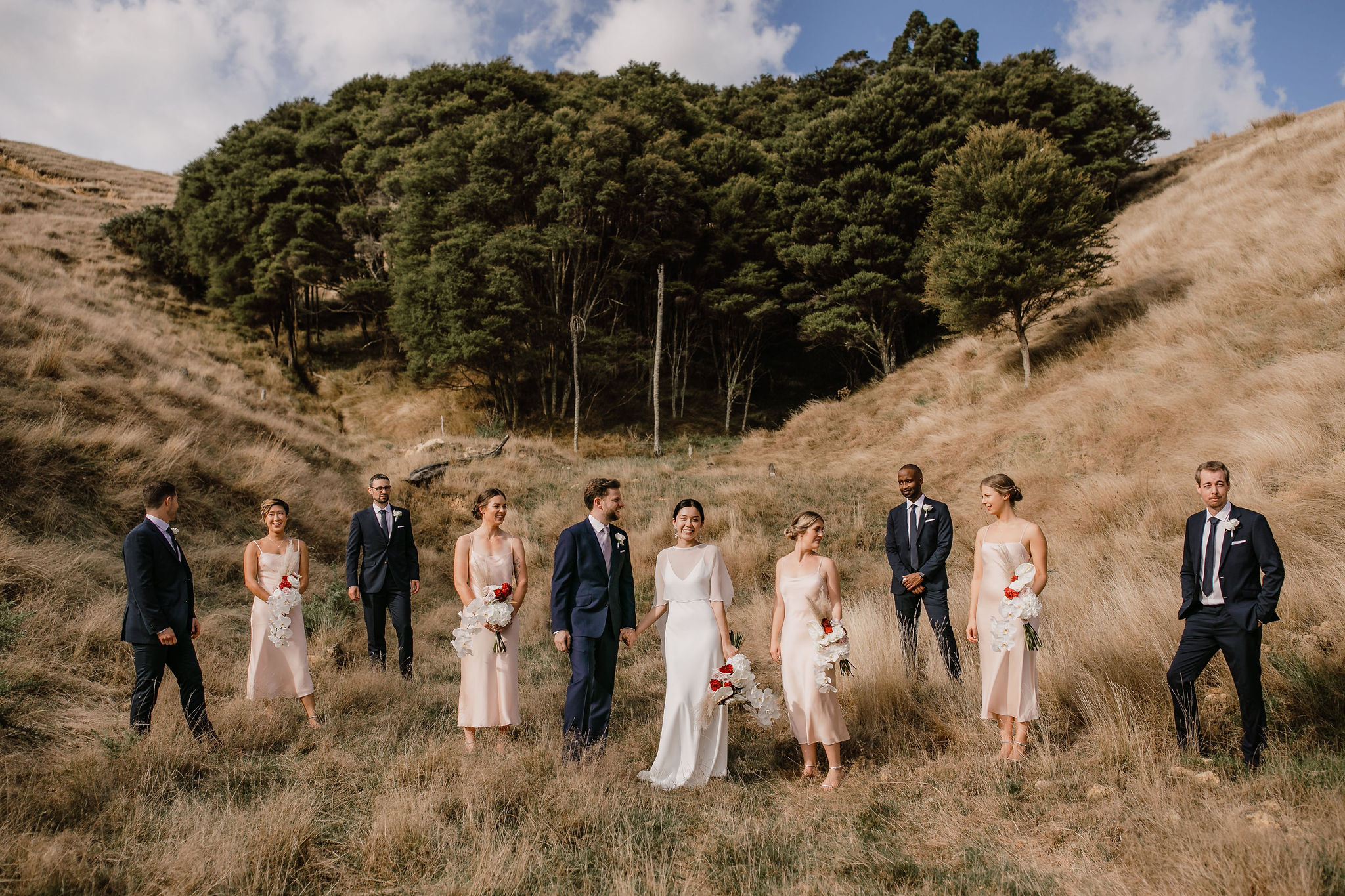 Modern bridal party with blush dresses at Kauri Bay Boomrock Auckland New Zealand Wedding