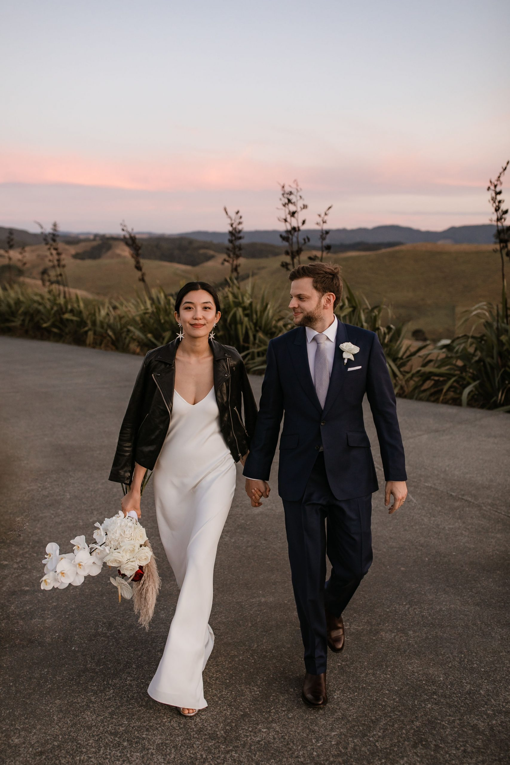 Modern Classic Bride and groom with leather jacket at Kauri Bay Boomrock Auckland New Zealand Wedding