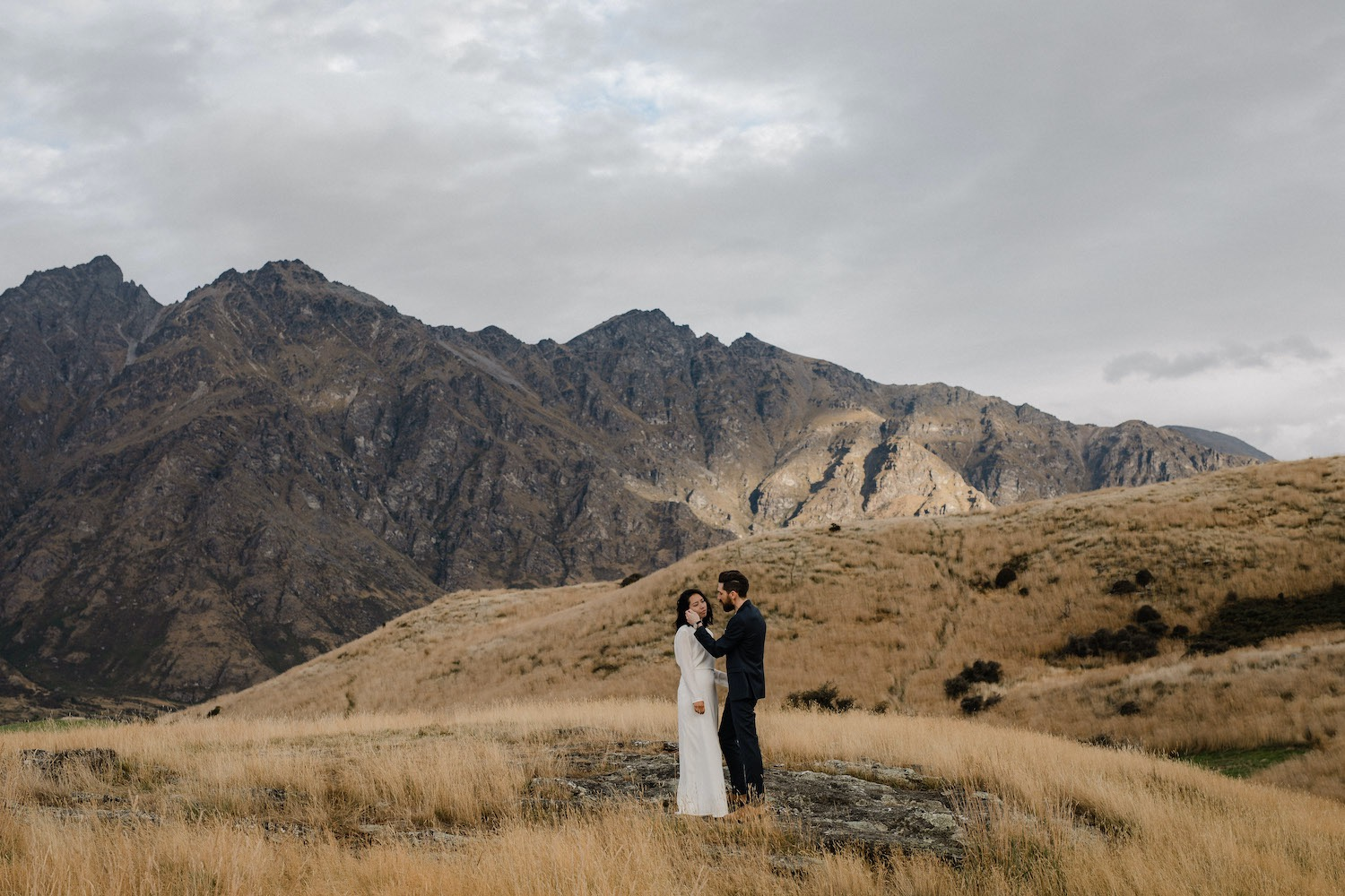 Bride and groom celebrating their elopement wedding in New Zealand