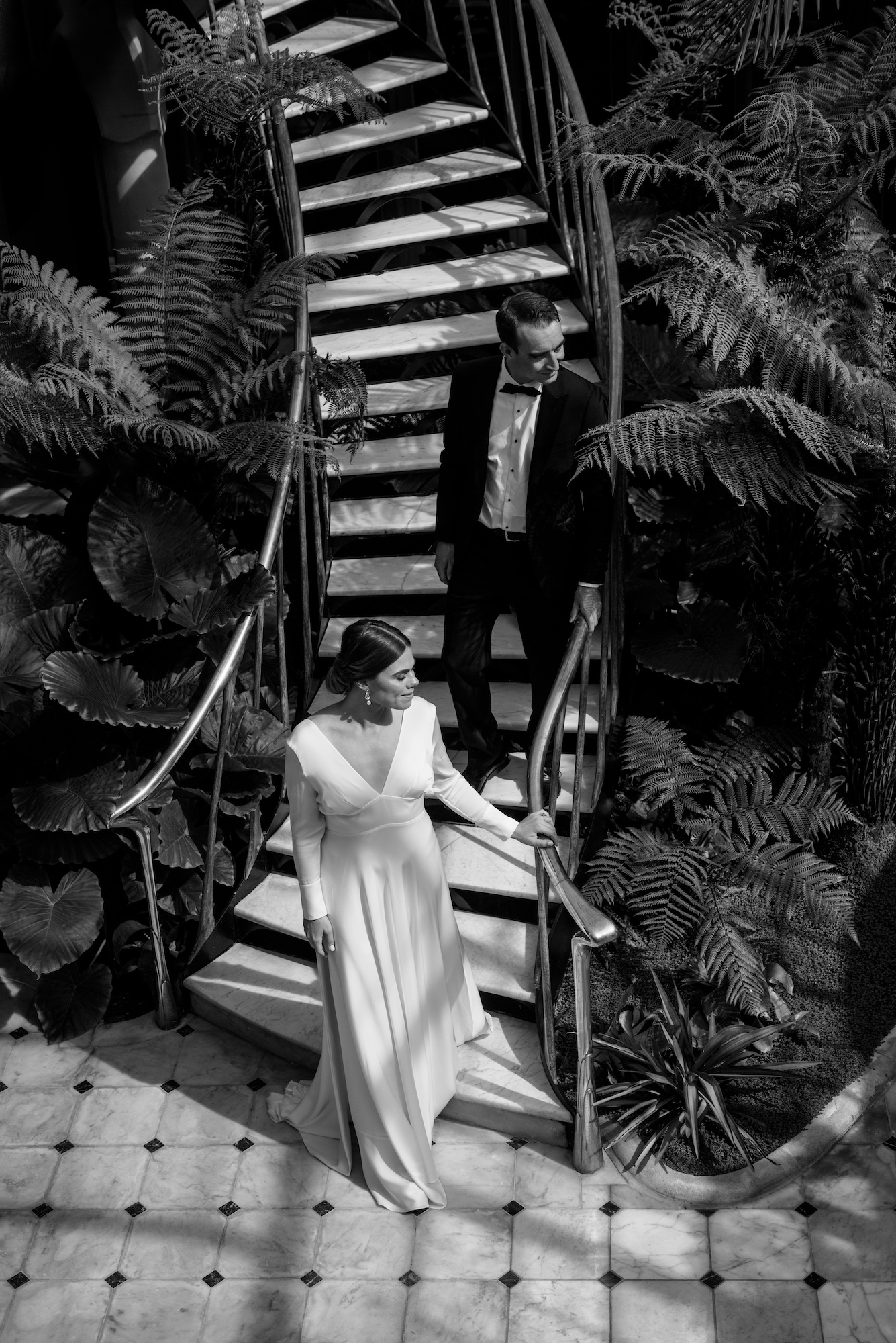 Bride and groom on staircase Modern Classic Christchurch New Zealand Wedding